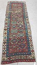 ANTIQUE CAUCASIAN RUNNER, hand knotted in an overa