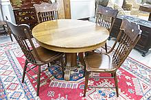 ROUND OAK DINING TABLE, FIVE CHAIRS AND SEVEN LEAV