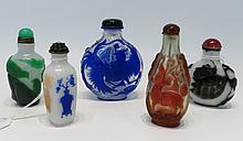 FIVE CHINESE PEKING GLASS SNUFF BOTTLES in various