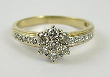 DIAMOND AND FOURTEEN KARAT GOLD RING, set with 17