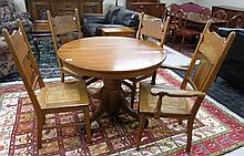 ROUND OAK DINING TABLE, FOUR CHAIRS AND TWO LEAVES