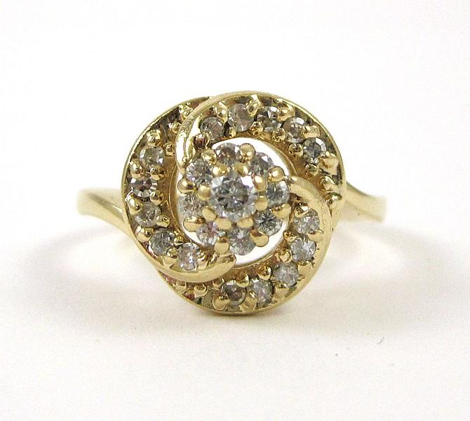 DIAMOND AND FOURTEEN KARAT GOLD RING set with 24