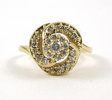 DIAMOND AND FOURTEEN KARAT GOLD RING, set with 24