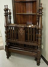 A PAIR OF WALNUT FOUR-POST TWIN BEDS WITH RAILS, A