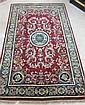 HAND KNOTTED ORIENTAL AREA RUG, Indo-Persian, floral disk medallion and surrounding acanthus decoration on madder red ground with green border, 3'11