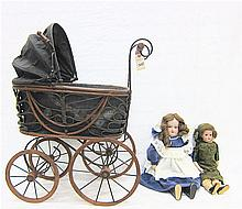 TWO GERMAN ANTIQUE DOLLS IN DOLL BUGGY: Armand