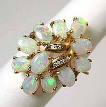 OPAL, DIAMOND AND FOURTEEN KARAT GOLD RING, set