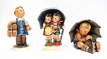 THREE GERMAN HUMMEL FIGURINES, of soft paste