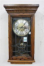 AN OAK CASE WALL CLOCK, San Francisco Clock Co.,