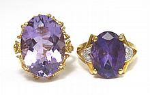TWO AMETHYST AND FOURTEEN KARAT GOLD RINGS, one