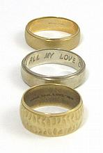 THREE FOURTEEN KARAT GOLD BANDS, including a