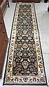 HAND KNOTTED ORIENTAL RUNNER, Indo-Persian, overall floral Kashan design on black ground, 2'6