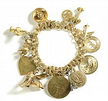 FOURTEEN KARAT GOLD CHARM BRACELET, measuring 7