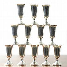 SET OF TWELVE STERLING SILVER CORDIALS, by