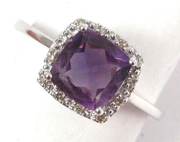 AMETHYST AND FOURTEEN KARAT GOLD RING, white gold
