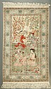 PICTORIAL SILK WALL RUG, featuring a scene of two Persian couples seated together in garden setting framed in a repeating Persian script cartouche border, 300-line quality (625 kpsi), 100% hand knotted fine silk on a foundation of silk, 3'1