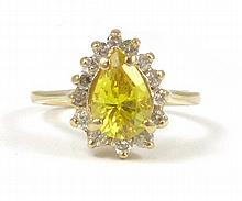 YELLOW ZIRCON AND FOURTEEN KARAT GOLD RING,