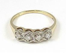 DIAMOND AND FOURTEEN KARAT GOLD RING, set with
