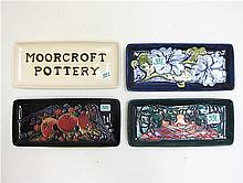 FOUR MOORCROFT POTTERY TRAYS, hand painted under