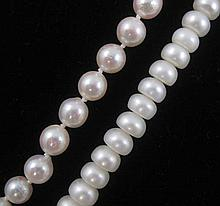 TWO SINGLE STRAND WHITE PEARL NECKLACES, including