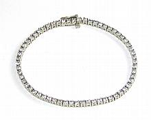 DIAMOND AND FOURTEEN KARAT GOLD TENNIS BRACELET.
