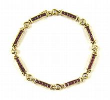 RUBY, DIAMOND AND FOURTEEN KARAT GOLD BRACELET,