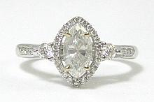 DIAMOND AND EIGHTEEN KARAT WHITE GOLD RING,