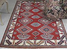 HAND KNOTTED ORIENTAL CARPET, a red field
