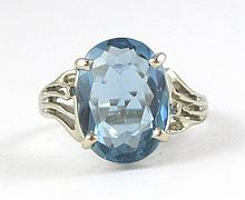 BLUE TOPAZ AND FOURTEEN KARAT WHITE GOLD RING, set