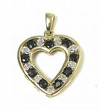 BLACK SAPPHIRE AND DIAMOND PENDANT. The 14k yellow