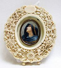 CARVED IVORY FRAME WITH PORTRAIT MINIATURE, the