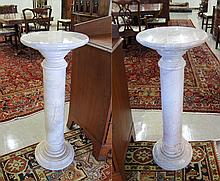 A PAIR OF ITALIAN PINK PERLINO MARBLE PEDESTALS.