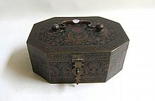 CHINESE METAL HINGE-TOP BOX of octagonal form with a bale handle and hasp latch. Dimensions 9.5