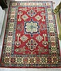 HAND KNOTTED ORIENTAL AREA RUG, Pakistani-Caucasian, featuring colorful geometric and curvilinear decoration on red ground, 3'3