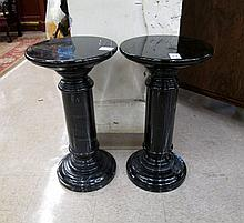 A PAIR OF BLACK ITALIAN MARQUINA MARBLE PEDESTALS, both of all marble construction including round tops, cylindrical columns and circular feet. Dimensions: 25.75