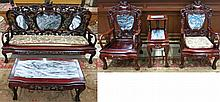 FIVE-PIECE SEATING FURNITURE AND TABLE SET, Chinese, 20th century, the carved rosewood and marble paneled set comprising: large sofa, pair  of armchairs, step-top end table and rectangular cocktail table.  Sofa dimensions: 40.25