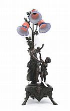 FIGURAL BRONZED RESIN TABLE LAMP, French Art Nouveau style, featuring goddess and putto figures under three art glass lily shades. Height 39.5 inches.