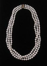 PRINCESS LENGTH TRIPLE STRAND PEARL NECKLACE having white strung pearls with a 14 karat gold  clasp. Length 18.5 inches.