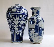 TWO CHINESE REPUBLIC BLUE GLAZED VASES, the first of baluster form having painted figures in an outdoor setting, height 15 inches. The second Mei Ping form vase having painted cobalt ground with banded designs of phoenix and flower, height 17 inches.