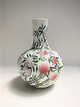 CHINESE QING DYNASTY LOW SHOULDER PEACH VASE having hand painted enamel peach branch with hanging fruit. Marked underfoot with reign mark. Height 15 inches.