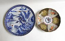 THREE ARTICLES OF ASIAN POTTERY including a Kutani stacking food box; Chinese blue and white porcelain charger, 16