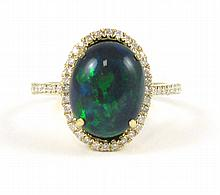 BLACK OPAL AND FOURTEEN KARAT GOLD RING, with round-cut diamonds set around an oval black opal cabochon weighing approximately 2.80 cts. Total  estimated weight for all diamonds: 0.32 cttw. Ring size: 7-1/4.