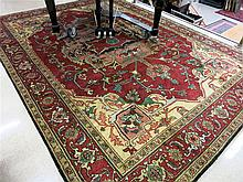 HAND KNOTTED ORIENTAL CARPET, Persian antique Serapi design, centering an extra large geometric and stylized floral medallion on elongated hexagonal red field, 8'11