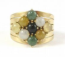 MULTI-COLOR JADE AND YELLOW GOLD RING. The wide  14k yellow gold band set with nine green, yellow, black and white round jade cabochons with diameters ranging from 4.0 to 4.4 mm.  Ring size:  7-3/4.
