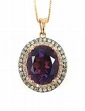 AMETHYST AND DIAMOND PENDANT NECKLACE, suspended on a 14k rose gold chain, the 14k rose and black end gold pendant with round-cut diamonds set around an oval-cut purple amethyst weighing approximately 3.90 cts. Estimated weight for all diamonds: 0.51