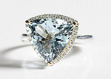 AQUAMARINE, DIAMOND AND WHITE GOLD RING The 14k  white gold ring with round-cut diamonds forming a frame around a trillion-cut aquamarine weighing  approximately 4.35 cts. Estimated weight for all diamonds: 0.27 cttw. Ring size: 7.