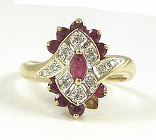 RUBY, DIAMOND AND TEN KARAT GOLD RING. The yellow and white gold ring centering a marquise-cut ruby with ten round-cut diamonds and nine round-cut rubies surrounding. Ring size: 6-3/4.