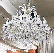 LOUIS XV STYLE CRYSTAL CHANDELIER, the 24 candlestick arms arranged in two tiers (8 over 16) and hung with a variety of clear crystal pendalogues including scalloped French style. Dimensions: 24
