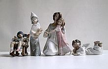 FOUR LLADRO FIGURINES, soft paste porcelain: