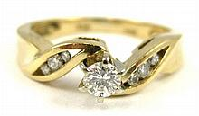 DIAMOND AND FOURTEEN KARAT GOLD RING, with three